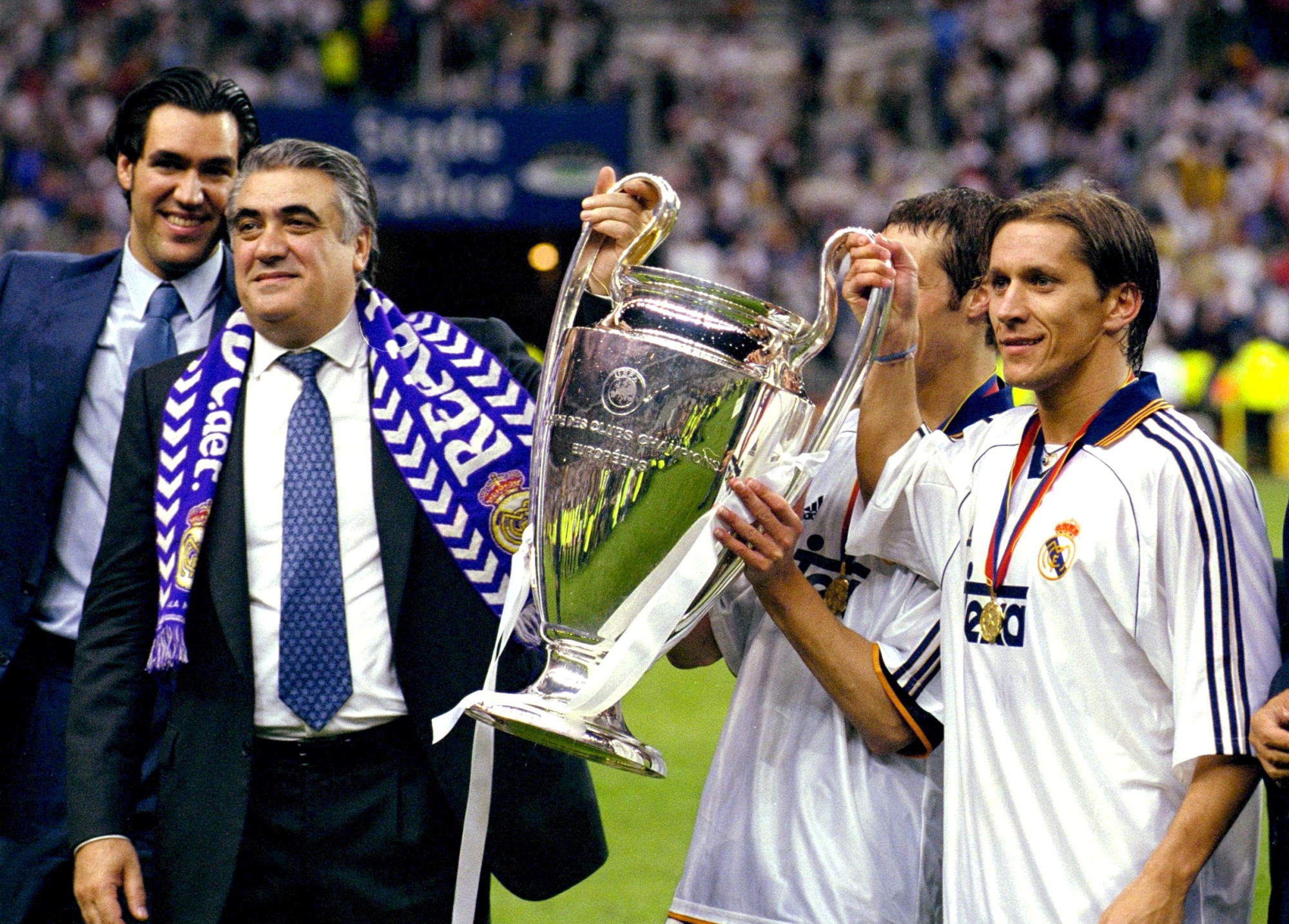 Former Real Madrid president Lorenzo Sanz (second from left) holds the Champions League trophy with Michel Salgado (right) on March 21, 2019, in Paris.   ACTION IMAGES