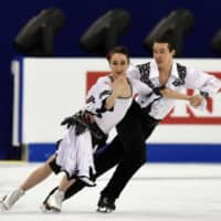 Ice dancers Chris and Cathy Reed compete at the 2015 World Figure Skating Championships in Shanghai. Chris Reed died of a heart attack last weekend at age 30. | AFP-JIJI