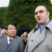 Former rikishi Roho (right) is seen in a December  2009 file photo. | KYODO