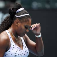 Serena Williams reacts after a point against China's Wang Qiang during their women's singles match on Day 5 of the Australian Open in Melbourne on Jan. 24. | AFP-JIJI