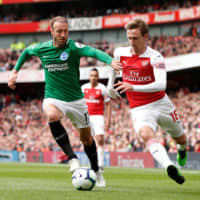 Brighton's Glenn Murray (left) and Arsenal's Nacho Monreal vie for the ball during a match on May 5, 2019, in London. | ACTION IMAGES VIA REUTERS