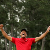 Tiger Woods reacts on the 18th hole after winning the Masters on April 14, 2019, in Augusta, Georgia. | REUTERS