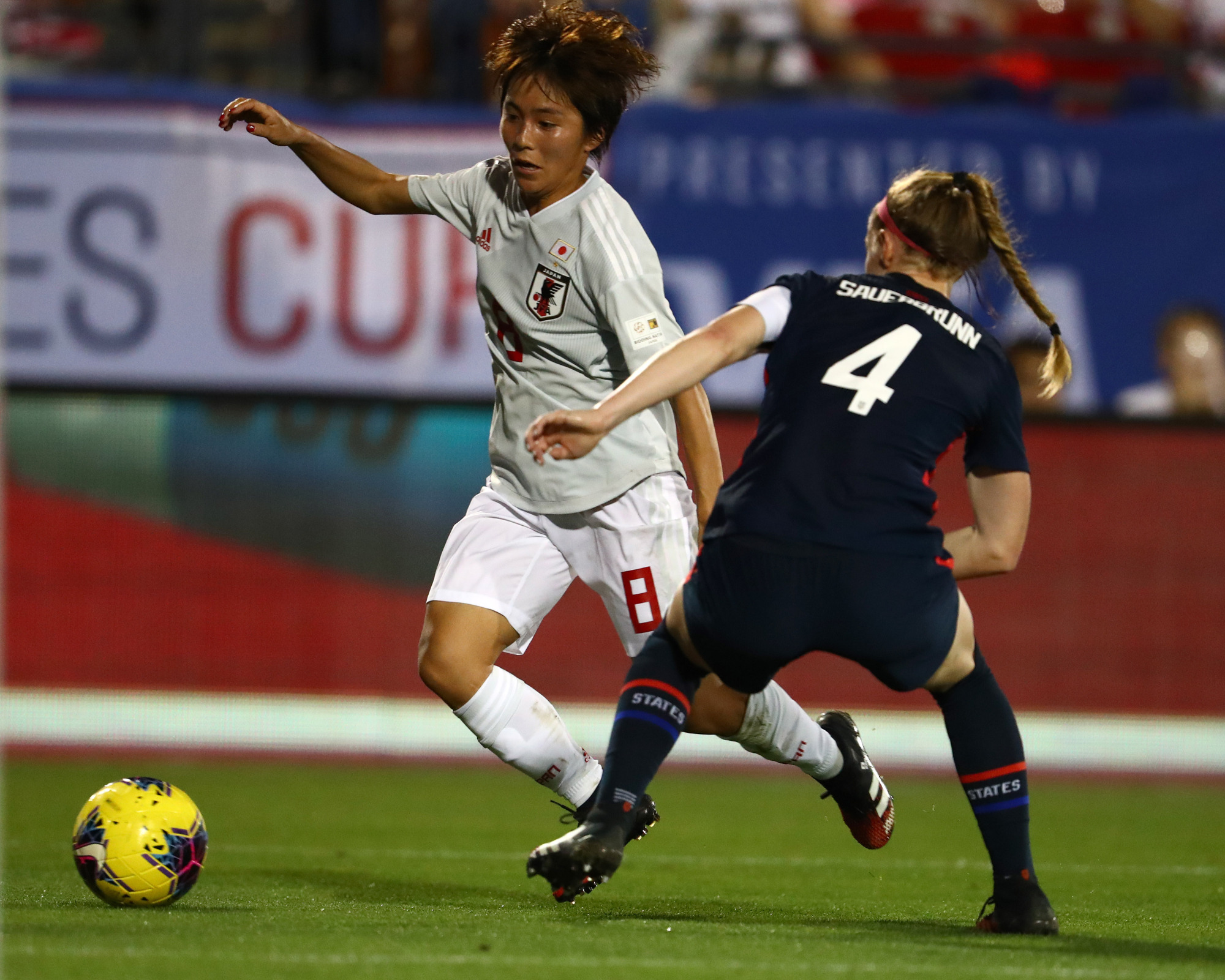 Japan's Mana Iwabuchi controls the ball in the second half against Becky Sauerbrunn of the United States in a SheBelieves Cup match on Wednesday in Frisco, Texas. | USA TODAY / VIA REUTERS