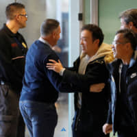 Members of the Wuhan Zall arrive at Malaga-Costa del Sol Airport from Istanbul on Jan. 29. The team returned to China on Monday. | REUTERS