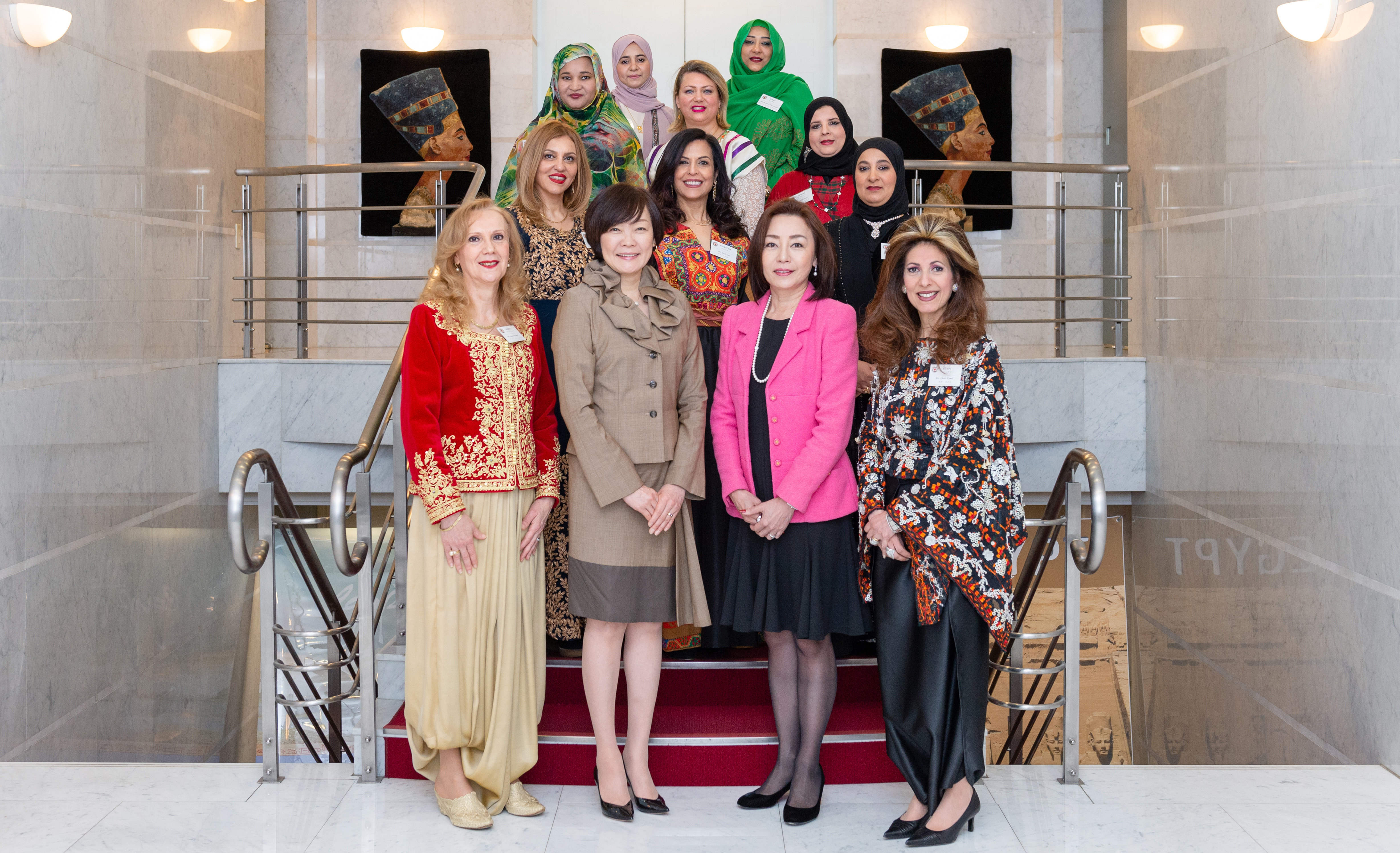 Japan's first lady Akie Abe (front row, second from left) and spouse of the minister for foreign affairs Emi Motegi (front row, second from right) pose for a group photo with President of  the Society of Arab Ambassadors and Heads of Missions in Japan (SWAAJ) and spouse of the Algerian ambassador Amira Bencherif (front row, left); SWAAJ Vice President and spouse of the Egyptian ambassador Ghada Kamel (front row, right); and other members at a luncheon hosted by SWAAJ at the Egyptian ambassador's residence on Feb. 13. Other members include representatives from Lebanon, Palestine, Bahrain, Mauritania, Tunisia, Kuwait, Oman and Sudan. | MIKI OSHITA