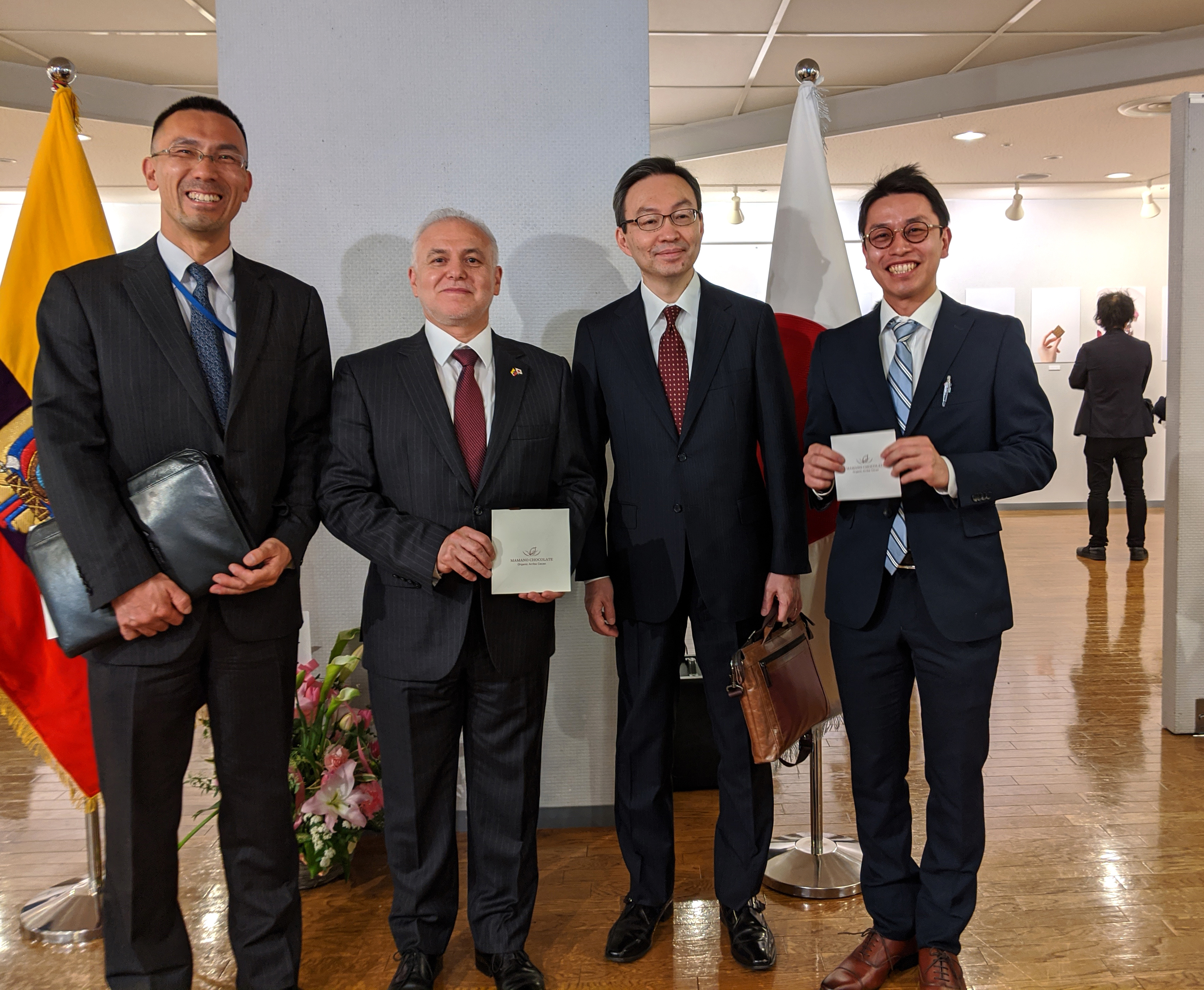 """From Left: Norifumi Kondo, director of the South America Division of the Latin American and the Caribbean Affairs Bureau, Ministry of Foreign Affairs; Jaime Barberis, ambassador of Ecuador to Japan; Yuji Sudo, ambassador of Japan to Ecuador; and Kotaro Ezawa, CEO of Mamano Chocolate Inc., at an opening ceremony of """"The Fine Aroma of Our Identity"""" exhibition hosted by the Ecuadorian Embassy and Mamano Chocolate, at the Takanawa Civic Center Gallery in Tokyo on Feb.25. Attendees enjoyed Mamano Chocolate's high-percentage cacao chocolate made with high-quality Ecuadorian fine aroma cocoa. 
