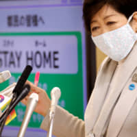 Tokyo Gov. Yuriko Koike speaks at a news conference on Tokyo's response to the coronavirus outbreak on Friday. | REUTERS