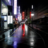 A street in Tokyo's Kabukicho entertainment district is almost empty Monday evening amid the coronavirus  outbreak. | REUTERS