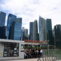 Singapore planning penalties for companies that don't follow social distancing rules