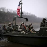 U.S. soldiers take part in a U.S.-South Korea joint river-crossing exercise near the demilitarized zone separating the two Koreas in 2016.   REUTERS