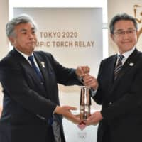 Olympic flame passed to Fukushima in low-key ceremony