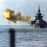 The battleship USS Idaho shells Okinawa on April 1, 1945. | U.S. NAVY