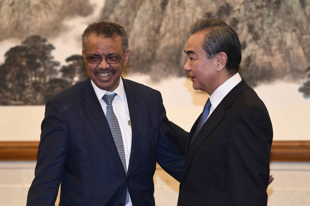 WHO Director General Tedros Adhanom attends a meeting with Chinese Foreign Minister Wang Yi in Beijing on Jan. 28