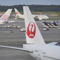 Japan Airlines Co. executives will voluntarily take a 10 percent cut in monthly remuneration from April to June as a cost-cutting measure. | BLOOMBERG