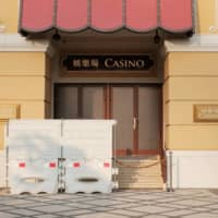 Barriers block a closed entrance to the Wynn Macau casino resort on March 24. | REUTERS