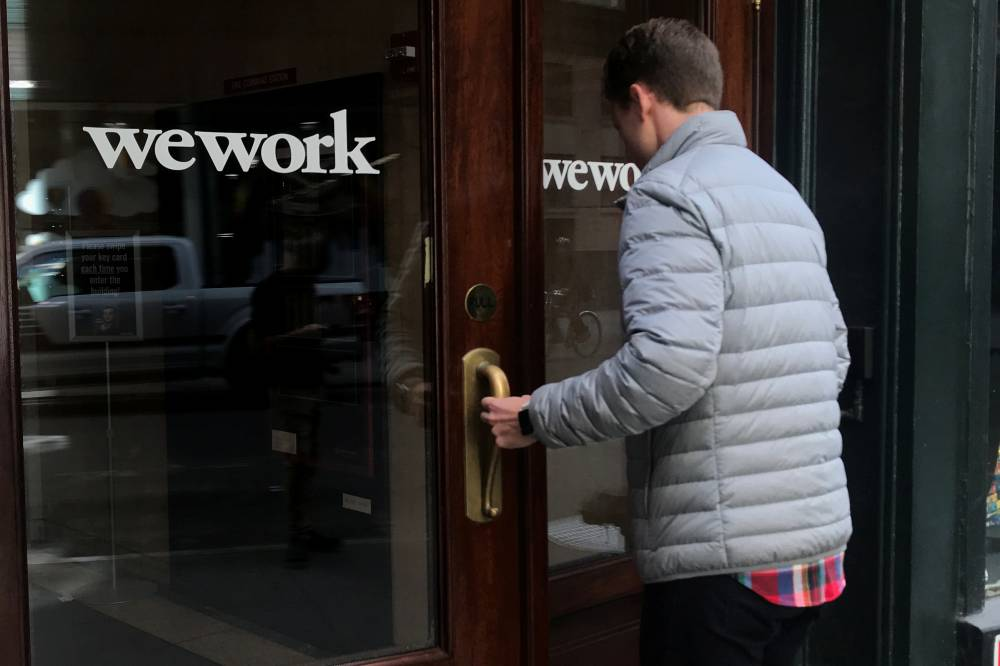 A man walks into a WeWork space in the Manhattan borough of New York on Oct. 4, 2019.   REUTERS
