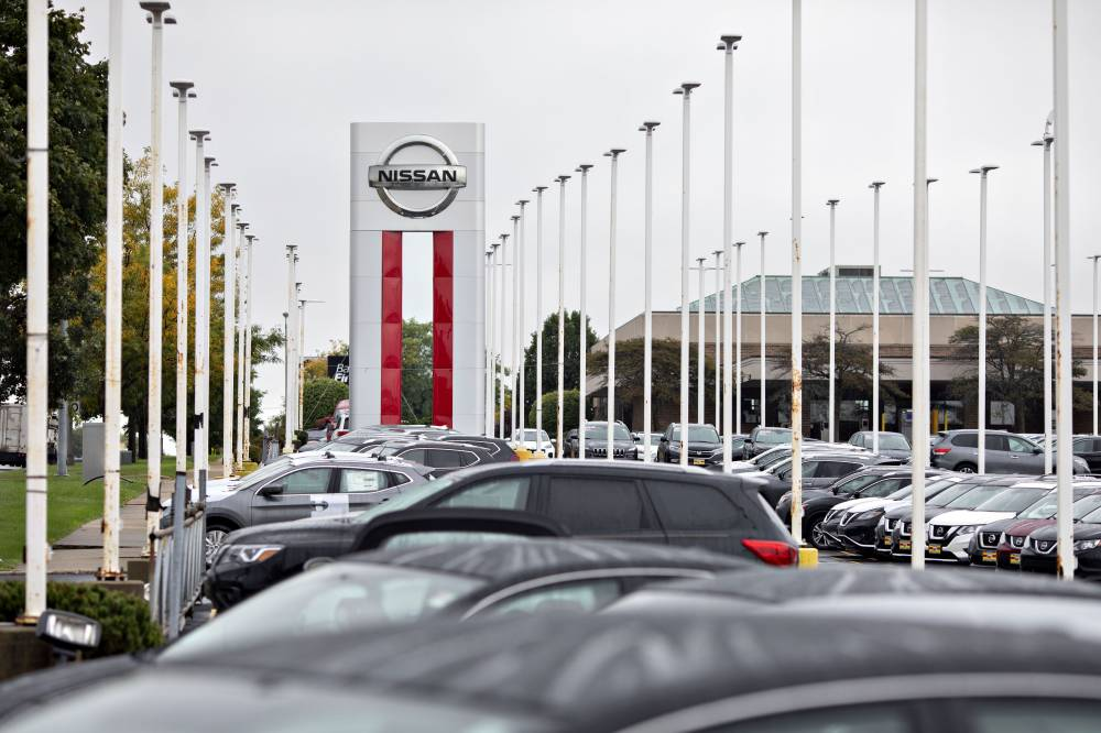 Nissan Motor Co. car dealership in Joliet, Illinois. Nissan said it will extend its factory suspensions in the United States through late April to help reduce the spread of the new coronavirus and protect employees. | BLOOMBERG