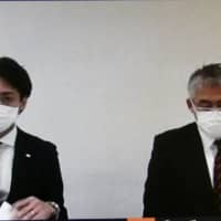 Osaka Evessa president Naoki Yasui (left) and general manager Tatsuya Abe address the media during a video news conference on Thursday, after revealing that one of their players has tested positive for the new coronavirus. | KAZ NAGATSUKA