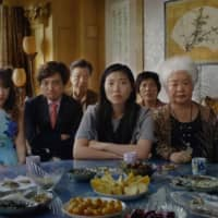 Family values: Aoi Mizuhara (second from left) plays a Japanese woman who takes part in a fake wedding to help her Chinese fiance's family in 'The Farewell.' | © 2019 BIG BEACH, LLC. ALL RIGHTS RESERVED