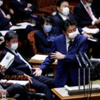 Prime Minister Shinzo Abe  speaks during an Upper House session on Tuesday. | REUTERS