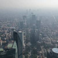 Air pollution clouds the sky over Mexico City on Monday.   AFP-JIJI