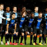 Club Brugge players pose for a group photo before a Europa League game against Manchester United on Feb. 27 in Manchester, England. | REUTERS