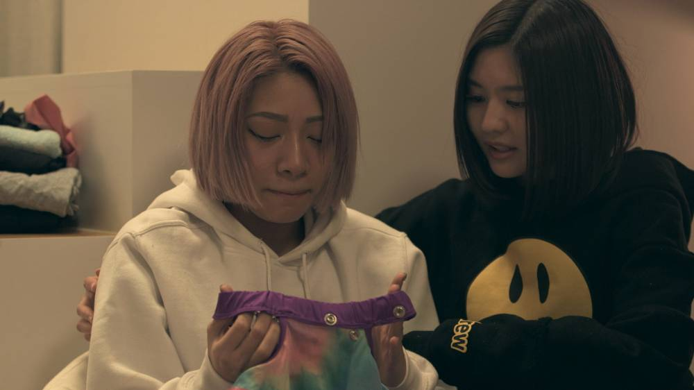 Crime of fashion: Hana (left) cries over her ruined wrestling outfit on 'Terrace House Tokyo 2019-2020.' | © FUJI TELEVISION / EAST ENTERTAINMENT