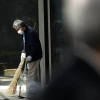 Americans warned to leave Japan or risk long stay as virus cases surge