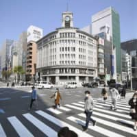 Fewer people than usual are seen in Tokyo's glitzy Ginza shopping district on Saturday as Japan struggles to slow the coronavirus pandemic. | KYODO