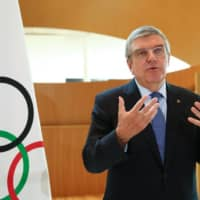 Man in the middle: International Olympic Committee President Thomas Bach speaks during an interview in Lausanne, Switzerland, on March 25 after the decision to postpone the 2020 Tokyo Olympics and Paralympics due to the coronavirus pandemic.             AFP-JIJI | AFP-JIJI