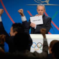 International Olympic Committee President Jacques Rogge announces the result of an election to host the 2020 Summer Olympics in Buenos Aires on Sept. 7, 2013. |  AFP-JIJI