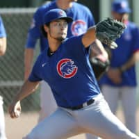 Cubs pitcher Yu Darvish pitches during a bullpen session on Feb. 17 in Mesa, Arizona.  | KYODO