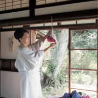 Petal prayers: Hirota hangs a hydrangea talisman from a beam near a doorway in her home. She does this every year during the rainy season to express her prayers for the good health of her family.   | SHOGO OIZUMI