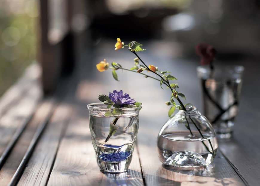 Bottled bliss: Seasonal flowers from the hills of Akiya, displayed in simple glass jars, offer cool relief from the mounting heat of early summer. | SHOGO OIZUMI