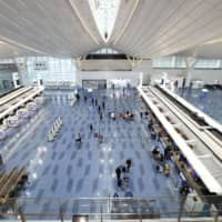 No crowds: Many flights have been canceled amid the spread of the new coronavirus, leaving Haneda airport's Terminal 3 pretty much empty. | KYODO