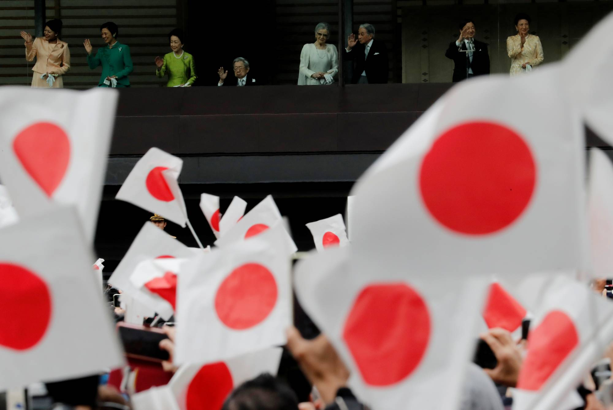 Members of the imperial family wave to well-wishers during a public appearance for New Year celebrations at the Imperial Palace in Tokyo on Jan. 2. | REUTERS