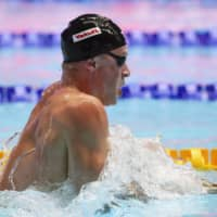 Adam Peaty sets a new world record in the semifinal of the 100-meter breaststroke at the 2019 World Aquatics Championships in Gwangju, South Korea, in July 2019. | KYODO