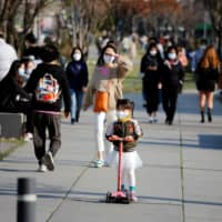 A girl rides a kick scooter at a park in Seoul on Friday.  | REUTERS