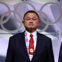 Japanese Olympic Committee President Yasuhiro Yamashita attends the 135th IOC session in Lausanne, Switzerland, on Jan. 10. | REUTERS