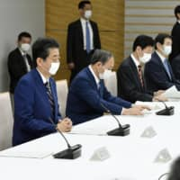 Prime Minister Shinzo Abe attends a meeting of government and ruling party officials at the Prime Minister's Office on Tuesday prior to declaring a state of emergency. | KYODO
