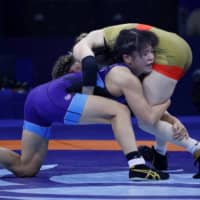 Haruna Okuno (left) competes against Sarah Hildebrandt during the women's 53-kg final at the world championships in Budapest on Oct. 25, 2018. | REUTERS
