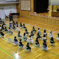 Children attend the entrance ceremony of an elementary school in Nagoya on Monday.