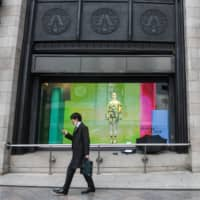 Japan firms to shut with emergency decree; 7-Elevens stay open