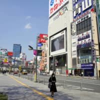 Major Japanese cities go quiet following state of emergency declaration