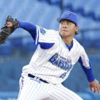 BayStars lefty Haruhiro Hamaguchi pitches against the Tigers during a training game on April 3 in Yokohama. | KYODO