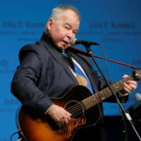 Musician John Prine performs at the John F. Kennedy Library in Boston in 2016.  | REUTERS