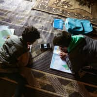 In war-torn Syria, digital learning only happens between power cuts