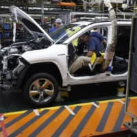 Workers assemble a RAV4 hybrid SUV at Toyota Motor Corp.'s plant in Georgetown, Kentucky in August  2019.   | BLOOMBERG