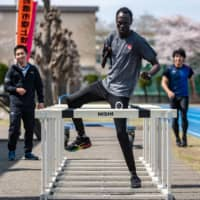 South Sudanese Paralympic runner Michael Machiek works out on April 3 in Maebashi, Gunma Prefecture. | AFP-JIJI