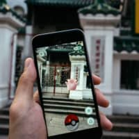 Clefairy, a character from the popular augmented reality game Pokemon Go, developed by Niantic Inc., is shown in front of Man Mo Temple on a smartphone in Hong Kong.   BLOOMBERG